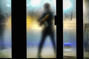 person cleaning Houston commercial glass door